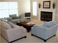 Classic Small Living Room Nuance In Beige Nuance With Soft Blue White Sofa And Maroon Sofa Table Also Tv Screen And Lovely Fireplace Idea - Use J/K to navigate to previous and next images