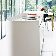 Keep it curvy with a Corian island and upstand