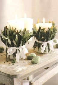 Olive leaves around candles. Will pin thre ribbon with pearl tipped pins instead of a bow.