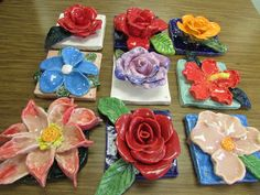 "Ceramic flower sculptures by 4th graders; approx. 7"" X 7""; art teacher: Susan Joe"