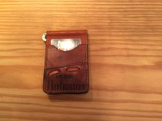 Vintage Nokona baseball glove wallet. Will hold credit cards in sleeves on outside of wallet and metal clasp will hold ten folded bills in center of wallet. Another nice front pocket wallet hand crafted by Little Freddie's. Check out more wallets on Facebook