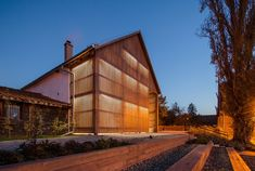 Image 1 of 17 from gallery of Visegad Town Center / aplusarchitects + stúdió. Photograph by The Greypixel Workshop Public Architecture, Tropical Architecture, Church Architecture, Architecture Design, Vernacular Architecture, New Urbanism, Modern Barn House, Contemporary Barn, Stone Barns