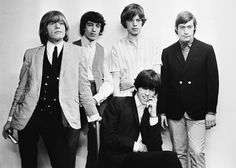 From left to right, Brian Jones (1942 - 1969), Bill Wyman, Mick Jagger and Charlie Watts, and (seated) Keith Richards of the Rolling Stones, circa 1965.