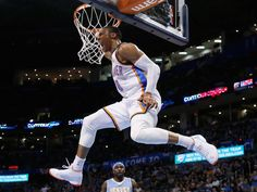 22 February 2015 Oklahoma City Thunder guard Russell Westbrook (0) hangs from the basket in front of Denver Nuggets guard Ty Lawson (3) following a dunk in the third quarter of an NBA basketball game in Oklahoma City. Oklahoma City won 119-945 AP/Sue Ogrocki