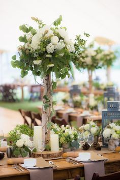 A lush table arrangement comprised mainly of greenery.