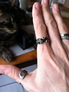 Blue tourmaline and rose cut diamond skinny stack. Oxidized silver with 14k white and rose golds. And as usual, the kitty prefers the box. www.varianceobjects.com