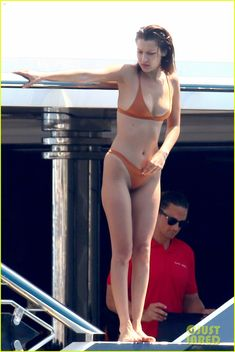 bella hadid jumps off a yacht in her bikini 01