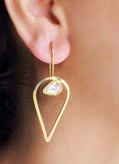 Contemporary and stylish, these Urban Dhani earrings are great for both work and play. The hoop earrings have a metal drop shaped like an inverted pear, with a large white crystal studded in it. The chic design and the clean lines of the earrings mean that they are a great option to enhance your work ensemble and give you a look that demands a second glance.