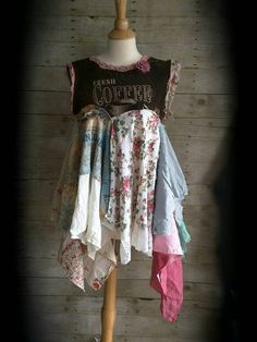 Boho rustic with a shabby touch. One of a kind country top, mini dress will make you feel oh so pretty with its unique beauty.  Coffee artsy Knit fabric top. Pixie style tattered ultra layered ruffled bottom with lots of mixed fabrics. Raw edges. Uneven hem. Added Lace and finished with a pink rose.   Super cute! Wear with boots or sandals. Fits Small to medium, please check MEASUREMENTS to ensure a good fit.    19 across under arm and stretches 24-44 long  Dressform measurements: 36 bust 28…