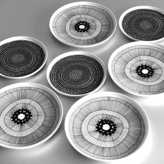Black and white modern organic patterned china plates.