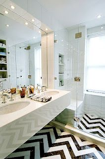 chevron tile floor really perks up this bathroom