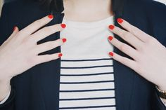 Red nails and stripes.