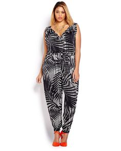 Here is a daring, sleeveless one piece that will surely get attention! Tropical black and white print plus size jumpsuit with cowl neckline and elastic waistband. 33 inch inseam. Wear it with bright colored pumps!