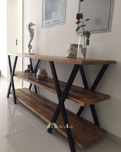 This stunning piece is highly multi-functional - use as a console, a bookshelf or an entertainment console! Wide spacious shelves provide tons of storage.  #industrial #design #rustic #home #decor #interior #Dubai #furniture #theatticdubai