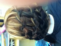 It's three waterfalls on top of each other with a french braid at the bottom and it's pulled into a side pony