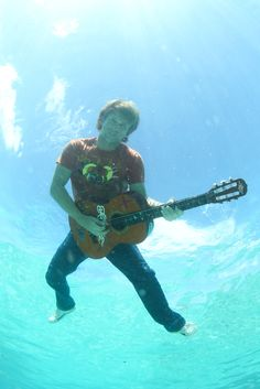 When you love music so much you end up playing a guitar under water!
