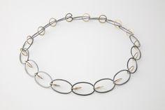 Circel Ovaal collier in zilver en geelgoud