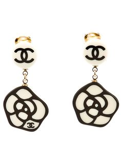 What I would give for these vintage Chanel earrings.  I was born in the wrong place and the wrong time! haha!