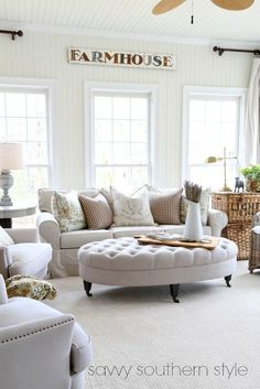 Check out this light and bright sun room filled with a mix of new and old. Neutral, vintage, checks, tufted, Pottery Barn basic sofa, farmhouse style.