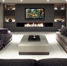 Modern basement. Tv in het midden boven gashaard