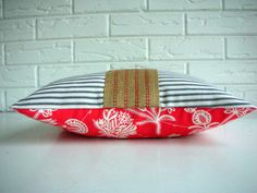 """Romantic meets shabby chic meets childhood longings all grown up in the cushion. Throw Pillow Decorative Lumbar - Black Ticking - Persimmon Red Cream Coral - Amy Butler - Jute Webbing - Farmhouse - Cottage Chic 10x16"""". $32.00, via Etsy."""