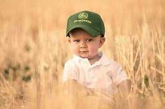 Little boy with his John Deere tractor hat