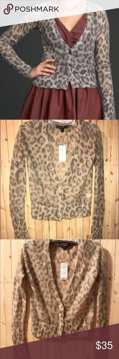 NWT Banana Republic X Mad Men Leopard Cardigan SP NWT Banana Republic X Mad Men Leopard cardigan. Size petite small. Color isn't that gray in my opinion, I showed a flash pic and a non flash pic. 3 buttons. One small hole (shown) not noticeable at all. Banana Republic Sweaters Cardigans