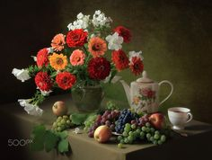 Still life with a bouquet of zinnias and fruit - null