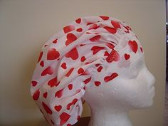 $9.99 This scrub hat has fun RED hearts that look kinda like they have been sponge painted on it, surrounded by tons of smaller solid RED H...