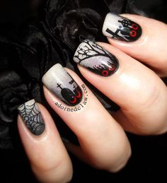 Creepy cemetery inspired nail art design. The foggy base color helps make the black polish silhouettes of the cemetery look even spookier. The bloody red polish also helps in adding the freaky factor.