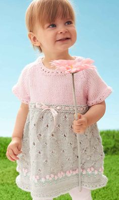 Free knitting pattern for Cozy Posie Dress - Adorable baby / toddler dress from Bernat features lace skirt with bobble flowers and eyelet lace at the neckline, sleeves, and waist. Sizes 6 mos, 12 mos, 18 mos, 24 mos