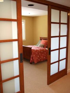 Two daylight basement bedrooms were combined into a guest suite. We replaced a wall of the typically dark 70's ranch corridor with shoji scr...