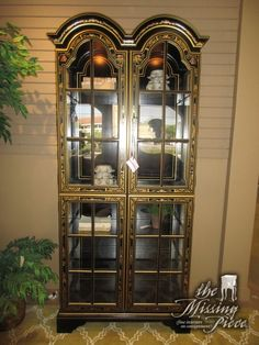 """Jasper painted curio cabinet in black. There are five glass shelves inside. It is lit as well. Excellent display piece for a dining room or a living room. Measures 36""""wide x 16""""deep x 77""""high."""