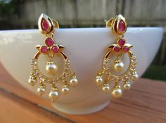 On Sale Ruby and Pearl Chandbali Chaandbalis Indian by Alankaar Gold Jhumka Earrings, Indian Jewelry Earrings, Gold Bridal Earrings, Jewelry Design Earrings, Gold Wedding Jewelry, Gold Earrings Designs, Gold Jewellery Design, Gold Drop Earrings, Pearl Necklace Designs