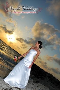 The rock jetty at Sand Key Park, Clearwater Beach, FL, is a great place to show off your beach wedding dress!