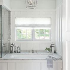 Board and Batten Bathtub with Marble Tub Deck