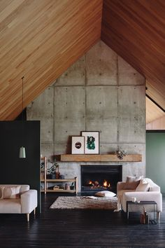 Oh, I do have a thing for concrete walls. There is something so industrial and sleek about them. I always love when they're paired with textile decor & a fireplace!