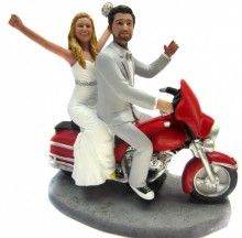 This site has tons of cute, custom wedding cake toppers