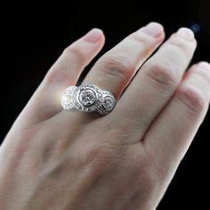 Bridget Three Stone Antique Engagement Ring: Diamond Accented Halo Design with Bezel set Round Brilliant Diamond Hybrids®
