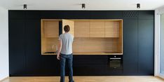 Slovenian firm Arhitektura d.o.o. crafts cabinetry within their small but spacious apartment designs.