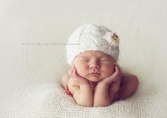 posing newborn babies