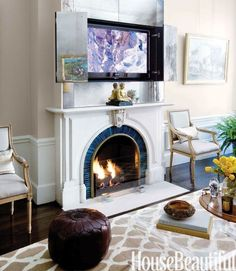gorgeous fireplace detail and love the mirrors hiding the tv