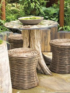 Rustic Chic: These basket weave stools and a table from a tree trunk blend seamlessly with a rustic-style garden
