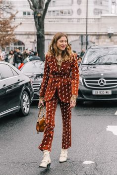 PARIS FALL 18/19 STREET STYLE II, velvet two piece suit in rust color with small white pattern, white ankle boots, velvet blazer and matching cropped pants in rust brown color,