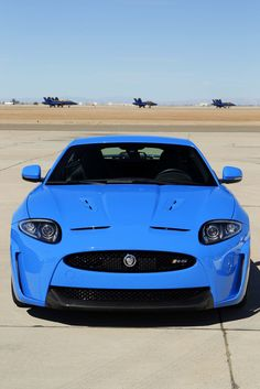 """Jaguar XKR-S...British... yes.....  Prim and Proper and void of Personality?....NO! .. This little """"blue devil"""" will run hard and wild....meet the new British!"""