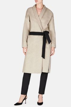 With a cut that evokes sculptural couture shapes, this wool-blend wrap coat typifies the refined yet casual luxury of Totême. A cozy shawl collar frames the relaxed, drop-shoulder silhouette, which is gently shaped by a set-in sash belt. The hidden-button front keeps the coat unadorned, while on-seam side pockets and deep side slits enhance the elegant ease.