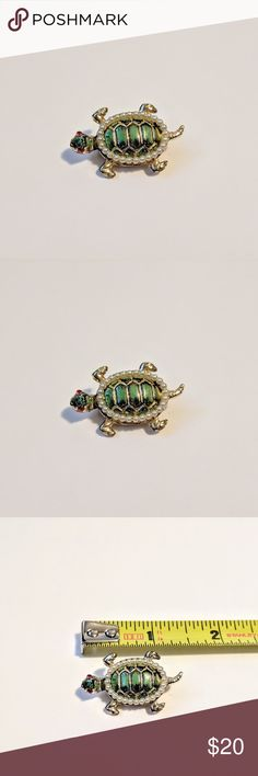 """Vintage Turtle Brooch or Scarf Pin Vintage turtle brooch with pearl detail.  Eyes are red and the body is gold color.  It was my great aunt's and a fantastic piece - - especially if you are a turtle lover!  It is fun and would look great as a scarf pin.  Looking for a good home - - unfortunately it just isn't my style.  - 1""""W x 1.5""""H - Gold color base and back - Pearl and red rhinestone detail - All stones and pearls intact - No scratches ? Jewelry Brooches"""