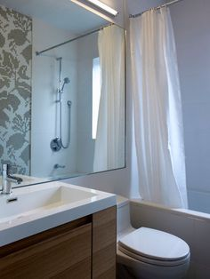 modern bathroom by blackLAB architects inc.  Timber vanity white solid surface top