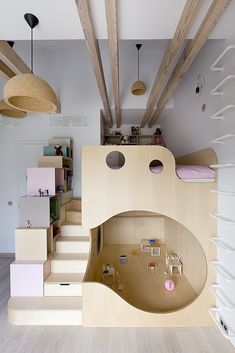 Tagged: Kids Room, Bedroom, Bunks, Bed, Shelves, Storage, Pre-Teen Age, Girl Gender, and Light Hardwood Floor. Photo 15 of 18 in A Dreamy Loft in Prague With Castle Views and an Onyx Moon