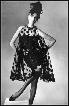 Wilhelmina is wearing a transparent black point d'esprit reembroidered with chiffon ribbon pompons, over a little black crepe dress by Townley, photo by Irving Penn, 1965